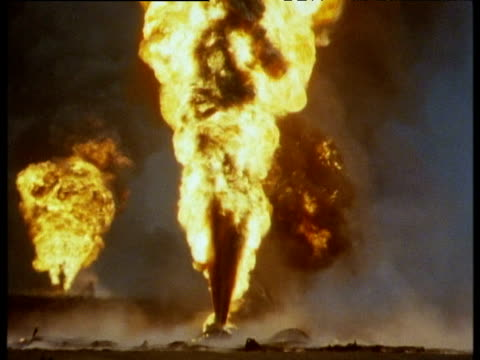 Burning oil well spews flames and toxic smoke, Kuwait, 1991