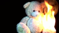 burning teddy in slow motion