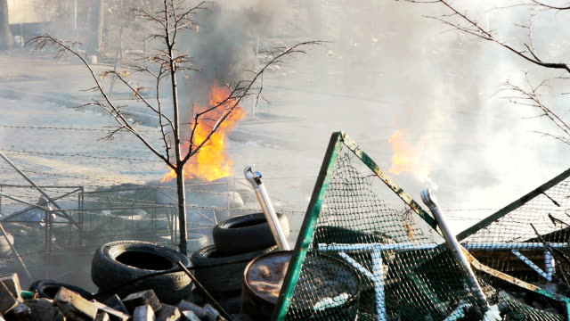 Burning tyres near barricade - Protests 2014