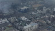 Burntout side of Takatori District of Kobe City Fire is still smoldering Wide shot Zoom in Streets where fire is still spreading Aerial shot