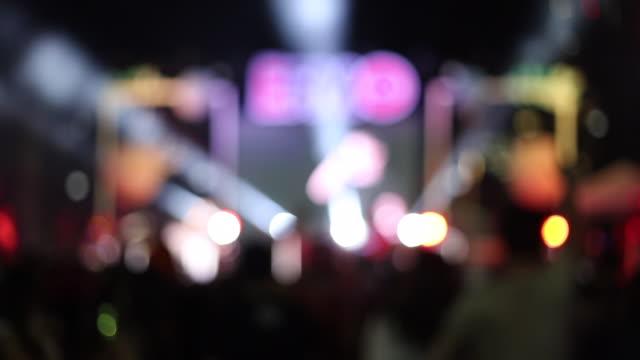 Burry background crowd people dancing in outdoor concert