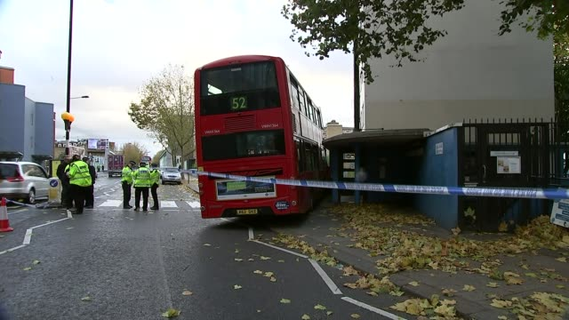 Bus crashes into pavement in Ladbroke Grove ENGLAND London Ladbroke Grove EXT Various shots 52 bus crashed into concrete wall Matt Ciprianou...