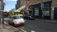 Bus crashes into shop front in Lavender Hill Kazim Doleker interview SOT Firefighters freeing trapped passengers from crashed bus Wide shot of cherry...