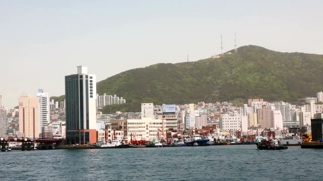 Busan Yeongdo-gu Island skyline with Busandaegyo bridge Panning HD shot