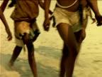 Bushmen walking across desert, Botswana