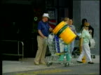 Asda Merger Talks with Kingfisher Group ITN GV 'WalMart' store Male shopper pushing trolley containing sack and buckets PAN Woman pushing trolley of...