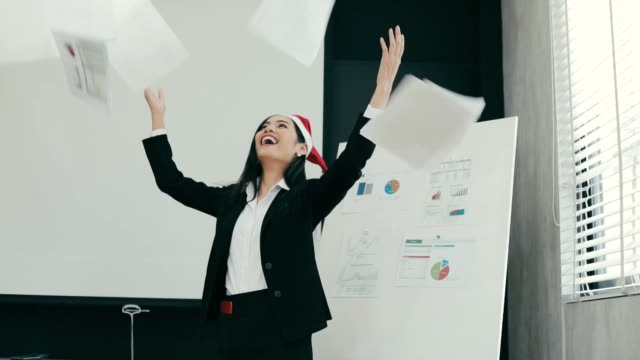 Business asian woman a throwing papers, concept End of the last day of the year