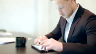 Business - Attractive business man using digital tablet