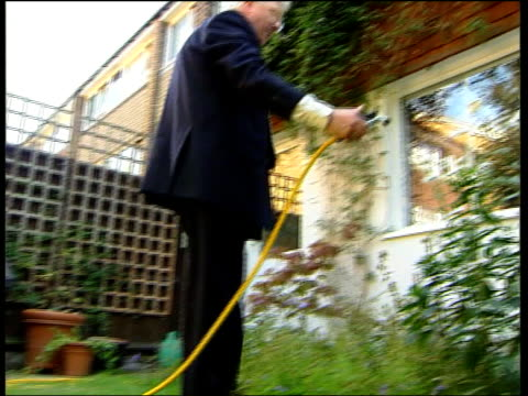 Banks Profits Concern Over Charges ITN Graves along Graves turning on garden tap Graves hosing plants Graves interview SOT Government should...