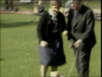 Banks Profits Concern Over Charges LIB Then Chancellor Sir Geoffrey Howe with wife Elspeth and dog Budget in park for photocall Howe and wife along...