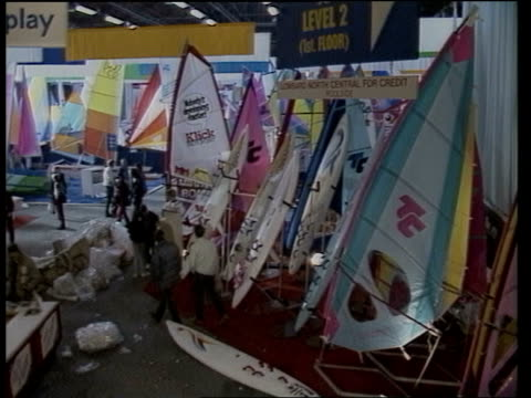 Boat Show ENGLAND London Earl's Court TS Boats on display MS Boats on display ZOOM IN to Nicholson 88 MS Salesman on boat MS 58ft sailing cruiser...