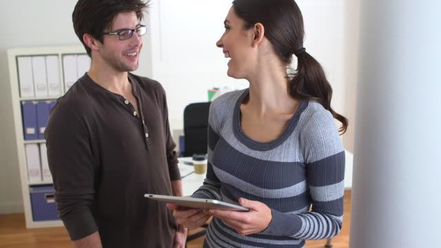 Business casual partners enjoying their work
