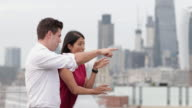 Business colleagues discussing London city skyline