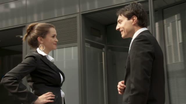 HD STEADYCAM: Business Couple Having A Conversation