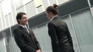 HD STEADYCAM: Business Couple Shaking Hands