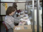 Credit Card Spending ENGLAND Southend TS People working in Access credit card office People working on computer terminals TS Woman working at...