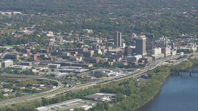 AERIAL Business district by river / Springfield, Massachusetts, United States