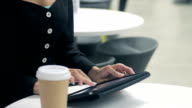 Business female working in Café on Tablet