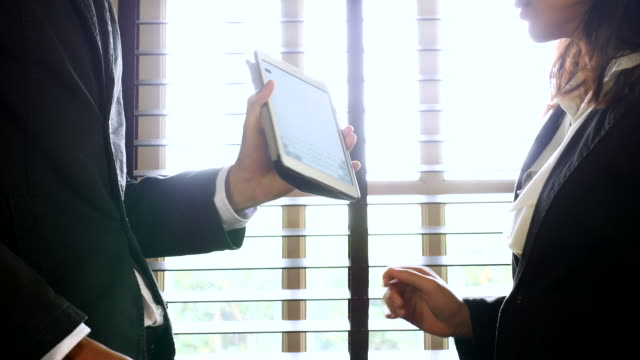 Business greeting with Digital tablet