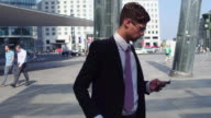 Business man checks direction on his phone