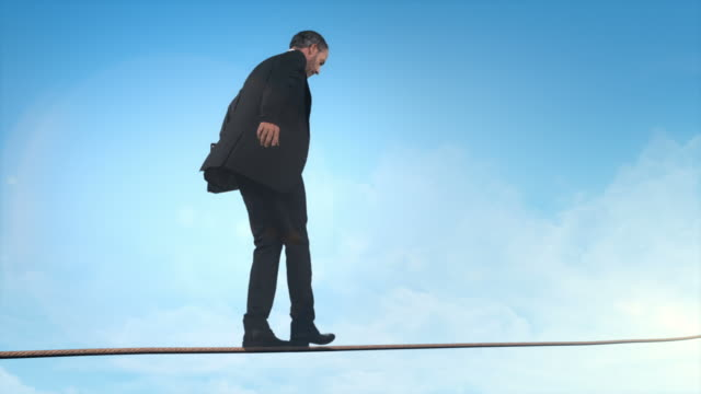 http://media.gettyimages.com/videos/business-man-doing-balancing-act-video-id145725747?s=640x640