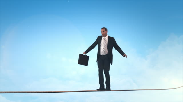 Business man doing balancing act