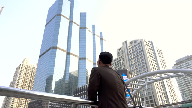 Business man looking forward to opportunity in modern city
