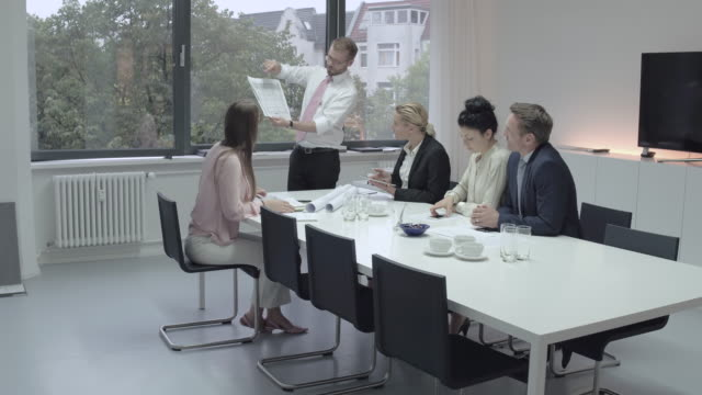 business man presenting a group of costumers his work