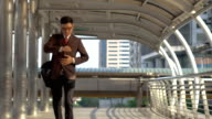 Business man rushing to work in modern city