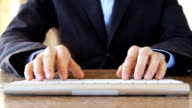 business man typing on computer keyboard