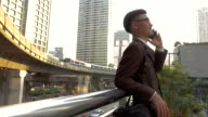 Business man using smart phone in modern city