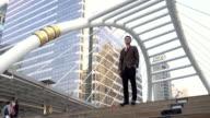 Business man walking to work in modern city