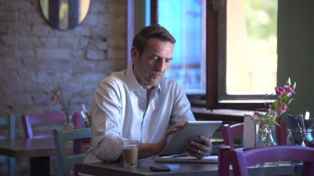 Business man woking in a café