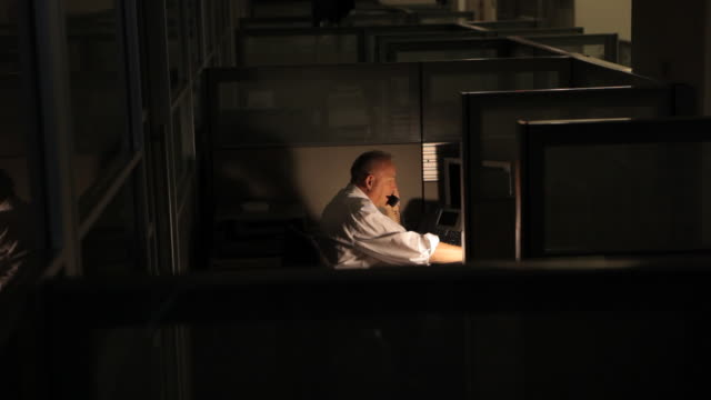 business man working late at an empty office