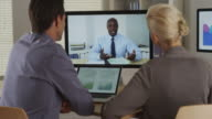 business manager remotely talking to his employees