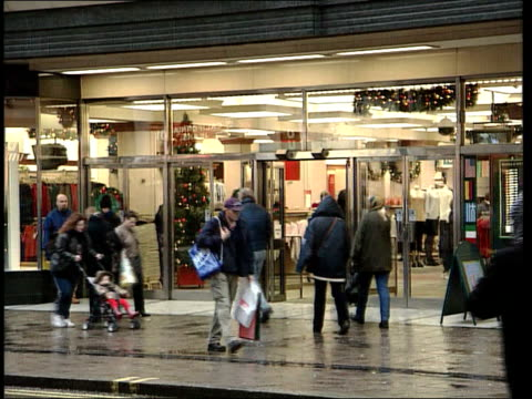 Marks and Spencer Takeover Rumours LIB ENGLAND London Marks Spencer store seen across road GV Entrance as people in and out BV Pay point TCMS...