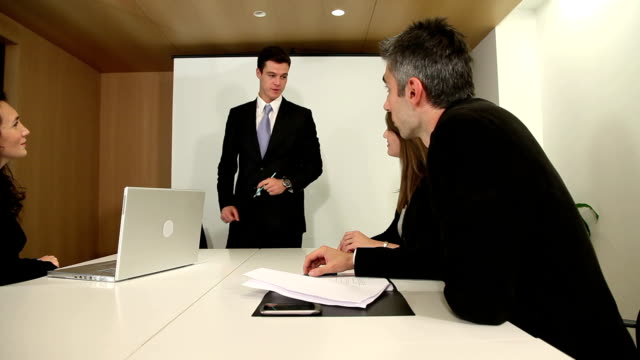 Business meeting where associate smiles at camera