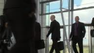 LA MS business men and women walking through lobby of building / London, UK