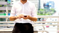 Business on the Go : Businessman using smartphone.HD format.