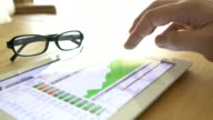 Business people analysing financial stock market data