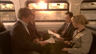 MS, Business people doing paperwork in train, Sydney, Australia