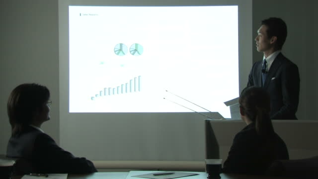 Business people having meeting, using projector