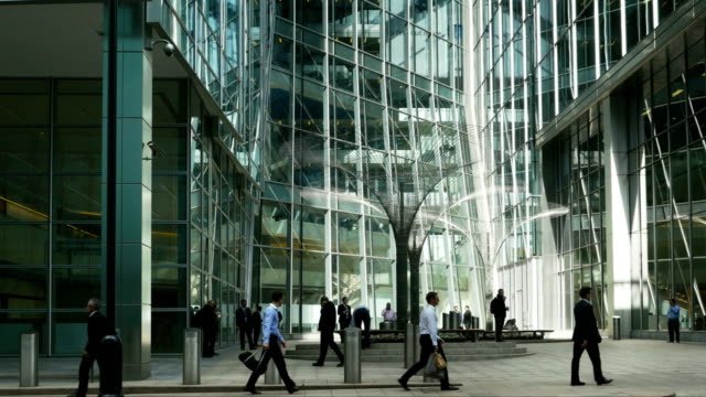 Business People In London Canary Wharf (4K/UHD to HD)