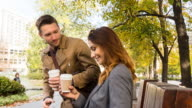 Business people meeting outdoors for coffee
