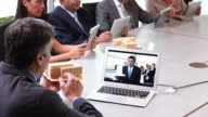 MS PAN Business People On Video Conference with Corporate Boardroom, Discussing Architectural Plans / Richmond, Virginia, USA