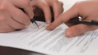 Business people signing sales agreement contract.