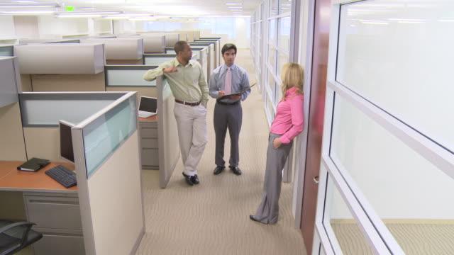 Business people talking in office hallway