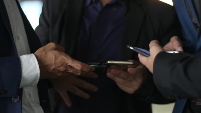3 Business people Using Social Media