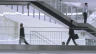 PAN Business people walking on the stairs in corporate building