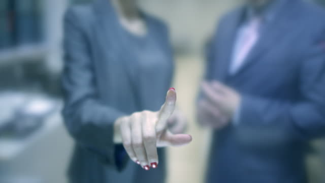 Business People-Hand Touching Tablet Computer Screen With Copy Space. Shallow DOF.